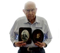 Mel Brewer holds photos of his grandmother, Emma Davis, and grandfather, John Cicero Brewer, at his apartment in Denton. Brewer, 90, recently turned over love letters written by his grandparents between 1878 and 1879 to the University of North Texas.
