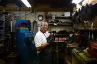 Raul Torres repairs the sole of a boot in the back room of Messina Shoe Repair in Farmers Branch. Kenneth Burks and his wife Nancy Burks have owned and operated the shop since 1964.ROSE BACA  -  neighborsgo staff photographer
