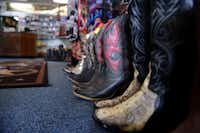 Used boots for sale at Messina Shoe Repair in Farmers Branch. Kenneth Burks and his wife Nancy Burks have owned and operated the shop since 1964.Rose Baca  -  neighborsgo staff photographer
