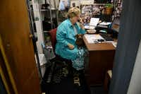 Nancy Burks answers the phone in the back office of Messina Shoe Repair.Rose Baca - neighborsgo staff photographer