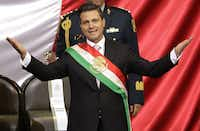 President Enrique Peña Nieto spread out his arms after his swearing-in during Saturday's inauguration ceremony at the National Congress in Mexico City.