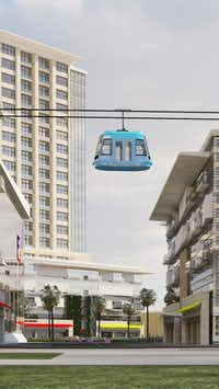 A computer rendering includes a gondola traversing the Dallas Midtown development.