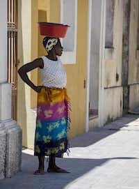 Many women  wear brilliantly colored capulanas.Mark Sissons  -  Special Contributor