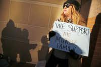 Autumn Brackeen of Fort Worth showed her support for the Muñoz family outside the Tim Curry Criminal Justice Center in Fort Worth on Friday.
