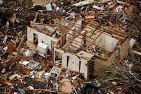 A Granbury home picked apart by a massive tornado Wednesday is one of hundreds damaged by the storm, which killed six people and injured dozens.