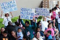 Demonstrators held signs calling for immigration reform during a  march and rally Sunday in downtown Dallas.