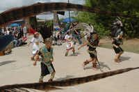 Ollin-Tonalzin, a tradional Aztec dance group perform for people during the third annual Fiesta LatinoAmericano.