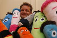 Troy Shull has found joy in his new business, which sells FuzzyHeads pillows for kids, among other items. He used his savings to start his venture.