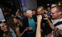 Sir Richard Branson mingled with the crowd during Monday's party at The Rustic.Michael Ainsworth - Staff Photographer
