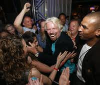 Sir Richard Branson greeted Lin Domingo after crowdsurfing at The Rustic.Michael Ainsworth - Staff Photographer