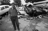 Paul Griffin had plenty to talk about in May1995 after floodwaters swamped his wife's car and others in Fair Park. City Manager Mary Suhm recalls that the receding water left cars piled four deep against a fence.