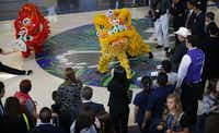 Lion performers from Lee's White Leopard Kung Fu School helped kick off American Airlines' new Asia service from D/FW.Tom Fox - Staff Photographer