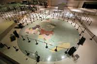 A map of the world covers the floor of the main lobby area at Dallas Love Field. A 2006 Wright amendment compromise, which takes effect in 2014, stipulated that commercial carriers could not fly to any international destinations from Love Field.