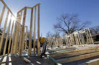 Francisco Izaguirre works for M. Christopher Company on a new home on a tear-down site in East Dallas.  Homebuilders are again scouting East Dallas and other close-in neighborhoods for old houses they can tear down for new construction.