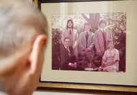 Arno Zwillenberg, 91, shows his family picture at his town home in Dallas on November 15, 2013. Zwillenberg is looking for a job. He is currently doing online training at his personal computer to become a notary public. (Kye R. Lee/The Dallas Morning News)Kye R. Lee - Staff Photographer