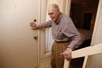 Arno Zwillenberg, 91, closes the door as Dallas Morning News reporter leaves at his town home in Dallas, TX on November 15, 2013. Zwillenberg is looking for a job. He is currently doing online training at his personal computer to become a notary public. (Kye R. Lee/The Dallas Morning News)Kye R. Lee - Staff Photographer