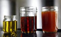 Sample jars hold (from left) processed biodiesel, filtered soybean oil, and unfiltered soybean oil.