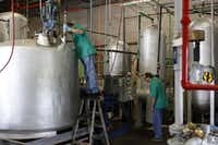 George Maayeh and Abraham Maayeh monitor biodiesel production at Texas Biotech in Arlington.