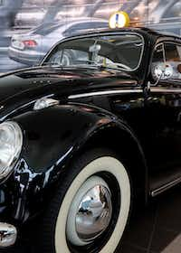A 1960s-era Beetle on the showroom floor provides inspiration to the staff at Lewisville Volkswagen.