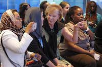 Documentary maker Kubra Jafari (second from left) of KJ Productions in Afghanistan gets tips from Terry Neese, who leads Peace Through Business. The initiative hosted 27 women from Afghanistan and Rwanda for a business boot camp.Louis DeLuca - Staff Photographer