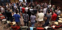 Over 100 employees of Watermark Community Church attend a weekly staff prayer meeting.