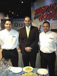 Juan Sotelo, food and beverage director of La Hacienda Ranch, left, with Alexis Georgiadis and server Jorge Castellano, made sure that the Texas margaritas served at the Smithsonian pre-opening party were up to Mariano Martinez's standards.
