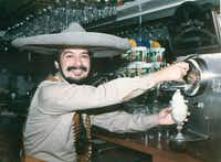 Mariano Martinez showed off his frozen margarita machine in 1991 at Mariano's in Old Town.