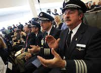 American Airlines pilot Capt. John Conrad (right) was among dozens of pilots, crew members and flight attendants who attended Wednesday's press conference at Dallas-Fort Worth International Airport.