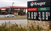Kroger and RaceTrac  advertised their fuel prices Wednesday on Broad Street in Mansfield.