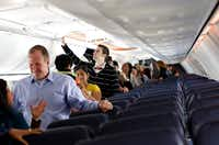 Employees tour a Boeing 737-800 at the launch party. Company officials say the larger planes will seat 38 more passengers per flight.