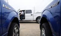 Marlon Reyes of Five Star Ford in Plano moves a 2013 Ford truck so he can get another one out of the lot. Dealers are stocking up with pickups in anticipation of a big sales battle in the next few weeks.