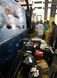 Passengers line up for boarding. Greyhound has been overhauling its fleet with new engines and interiors to serve 10.5 million riders annually, a number it hopes to triple.Photos by Louis DeLuca - Staff Photographer