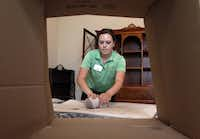 Beth McGee of Senior Focused Relocations packs the belongings of Paul and Patsy Phillips. The company carefully labels items so that they are in the same spots when seniors take up residence in their new place.