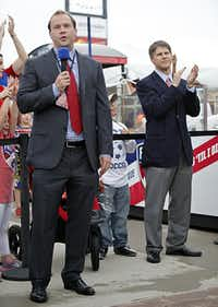 Dan Hunt (left) and brother Clark spoke to fans during the ceremonial scarfing of their father Lamar's statue before FC Dallas' game against San Jose in late May at FC Dallas Stadium in Frisco.