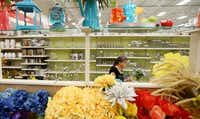 Deb Cummings of Dallas  shops for artificial floral arrangements at a Michaels store in Plano. Irving-based Michaels, which was public until 2006, started selling shares again last Friday.Andy Jacobsohn - Staff Photographer
