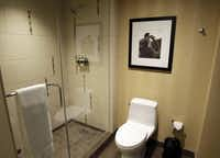 Guest rooms feature showers, not bathtubs. Employees suggested locating the shower handle on the wall opposite the shower heard.