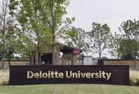 Trees surround the entrance to Deloitte University, which features high-tech training in a rustic setting.