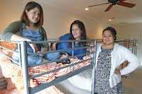 Furniture has arrived, including bunk beds, for the Tech WildCatters startup house. Setting up one of the dorm rooms are TechWildcatters team members Michaela Lassig (left),  Gabriella Draney (center) and Raquel Vincent.