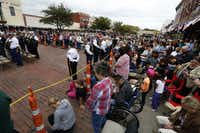 Hundreds attended Tuesday's ceremony in downtown Farmersville, some hanging out of windows or standing on nearby roofs.