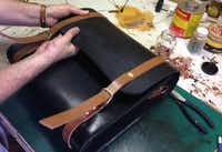 Cummings, who sells his items through Etsy, fashions a carry-all. He took up leather crafting after finding himself at loose ends when the business he worked for was sold.Louis DeLuca - Staff Photographer