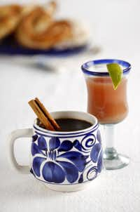 Relax after your meal with coffee with a cinnamon stick stirrer and an orange juice and cranberry cocktail.