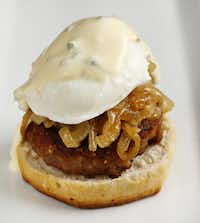 Go South by Southwest with a split biscuit, caramelized onions, specy breakfast sausage, the poached egg and hollandaise with minced jalapeno.