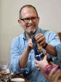 How do you open this? Panel guest Ron Ruggless helps tear into one of the offerings at the tasting.