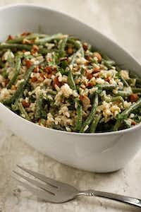 Satisfy your Parisian palate with haricots verts, rice and toasted almonds, served cold. Read the story for the recipe.Evans Caglage - Staff Photographer