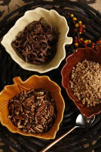 Thanksgiving Desserts, photographed October 31, 2012. Toppings for Pumkin Pie, clockwise from top, chocolate shavings, Heath Toffee Bits, and toasted nuts.