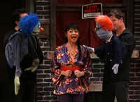 James Chandler, left, as Nicky, Olivia de Guzman Emile, center, as Christmas Eve, and Michael Robinson, right as Rod, perform the opening number of Avenue Q on January 11, 2014 at Stage West Theatre in Fort WorthSarah Hoffman - Staff Photographer