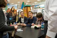 (L to R) Jake Abel, Max Irons and Chandler Canterbury of the upcoming film The Host sign autographs for fans at the Barnes & Noble on Northwest Highway in Dallas on Tuesday, March 12, 2013.