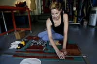 """Artist Linsey Stiles creates from home in her garage studio on August 20, 2013 in Dallas. Stiles designs and creates purses, styles makeup, does printmaking and sells vintage clothing. """"I love coming up with new ideas, I love color and I love quality materials,"""" Stiles said."""