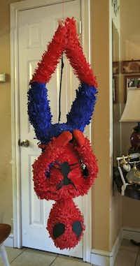 A custom designed Spider-Man piñata hangs around Maria Barrera's house, awaiting pick-up.Evans Caglage  -  Staff Photographer