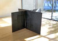 """Richard Serra's """"Inverted House of Cards,"""" four panels of streaked Corten steel, is minuscule compared to the vast ribbons and circles for which the sculptor is best known."""